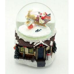 Spieluhr Schneekugel mit Santa und Schlitten